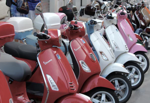 electric scooters being lined up on the streets